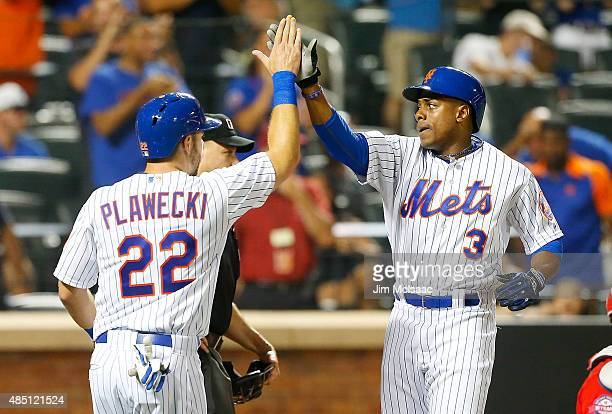 Curtis Granderson and Kevin Plawecki of the New York Mets in action against the Washington Nationals at Citi Field on August 2 2015 in the Flushing...