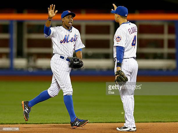Curtis Granderson and Wilmer Flores of the New York Mets celebrate the 75 win over the Miami Marlins on April 16 2015 at Citi Field in the Flushing...