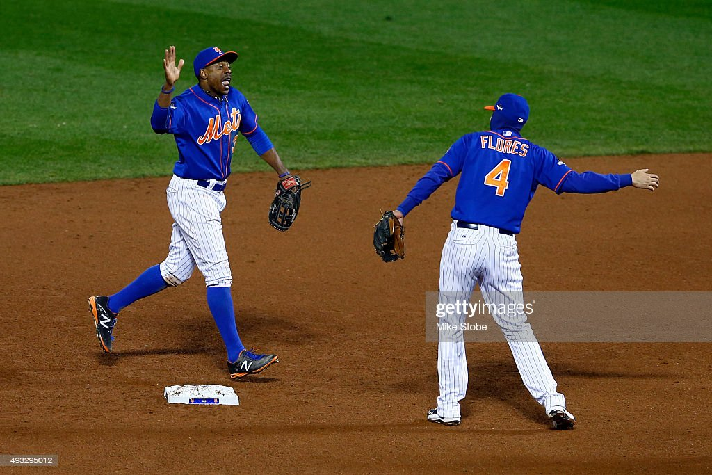 Curtis Granderson #3 and Wilmer Flores #4 of the New York Mets celebrate after defeating the Chicago Cubs in game two of the 2015 MLB National League Championship Series at Citi Field on October 18, 2015 in the Flushing neighborhood of the Queens borough of New York City. The Mets defeated the Cubs with a score of 4 to 1.