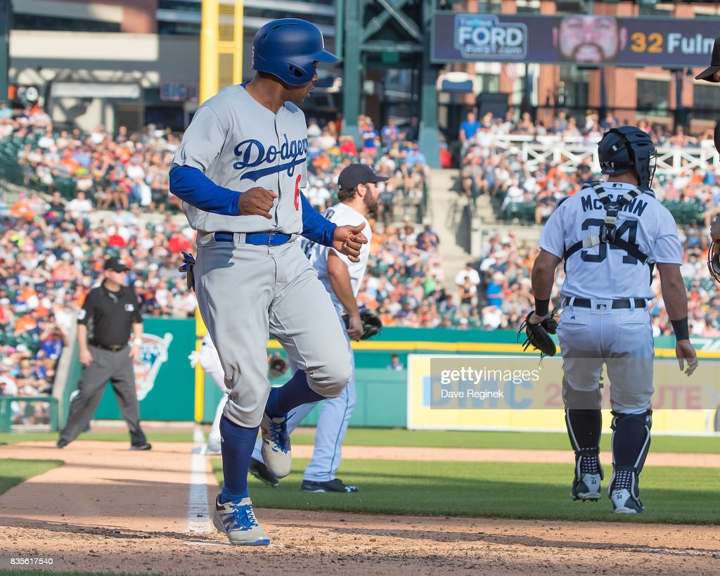 Curtis Granderson #6 of the Los Angeles Dodgers scores a run in the seventh inning against the Detroit Tigers during a MLB game at Comerica Park on August 19, 2017 in Detroit, Michigan.