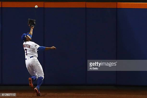 Curtis Granderson of the New York Mets catches a ball hit by Brandon Crawford of the San Francisco Giants for an out in the fifth inning during their...