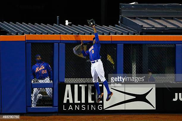 Curtis Granderson of the New York Mets catches a pop up fly hit by Chris Coghlan of the Chicago Cubs in the second inning against Noah Syndergaard of...