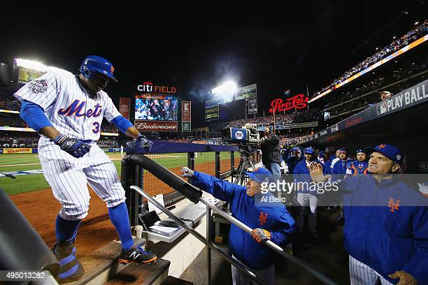 Curtis Granderson of the New York Mets celebrates after hitting a two run home run in the third inning against the Kansas City Royals during Game...
