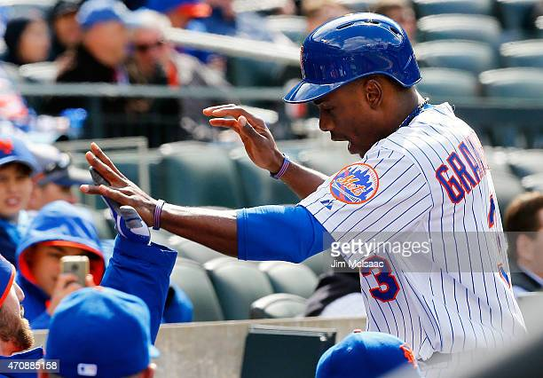 Curtis Granderson of the New York Mets celebrates in the dugout after scoring the go ahead run in the fifth inning against the Atlanta Braves at Citi...