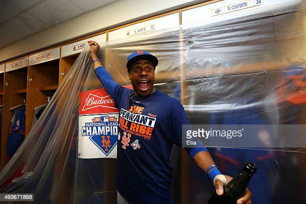 Curtis Granderson of the New York Mets celebrates in the locker room with his teammates after defeating the Chicago Cubs in game four of the 2015 MLB...