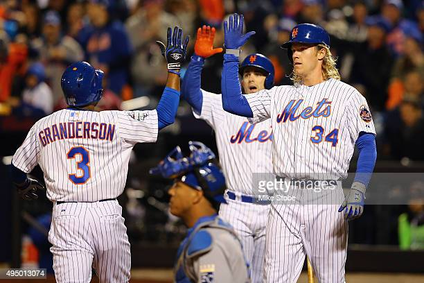Curtis Granderson of the New York Mets celebrates with Noah Syndergaard and David Wright after hitting a two run home run in the third inning against...
