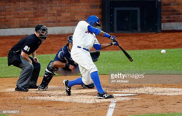 Curtis Granderson of the New York Mets connects on a third inning base hit against the Atlanta Braves at Citi Field on July 9 2014 in the Flushing...