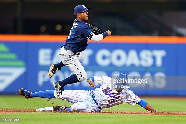 Curtis Granderson of the New York Mets is forced out as Alexi Amarista of the San Diego Padres completes the double play in the first inning at Citi...