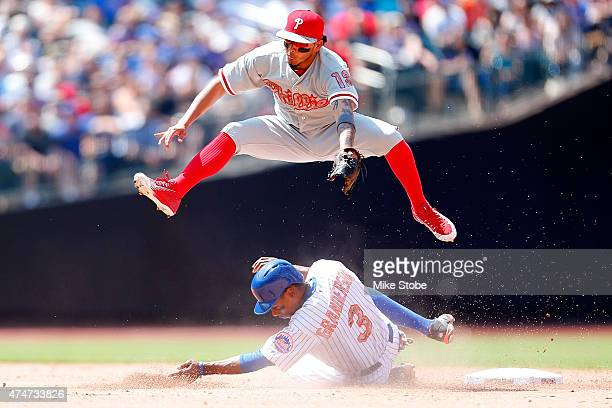 Curtis Granderson of the New York Mets is forced out at second as Freddy Galvis of the Philadelphia Phillies completes the double play in the fifth...