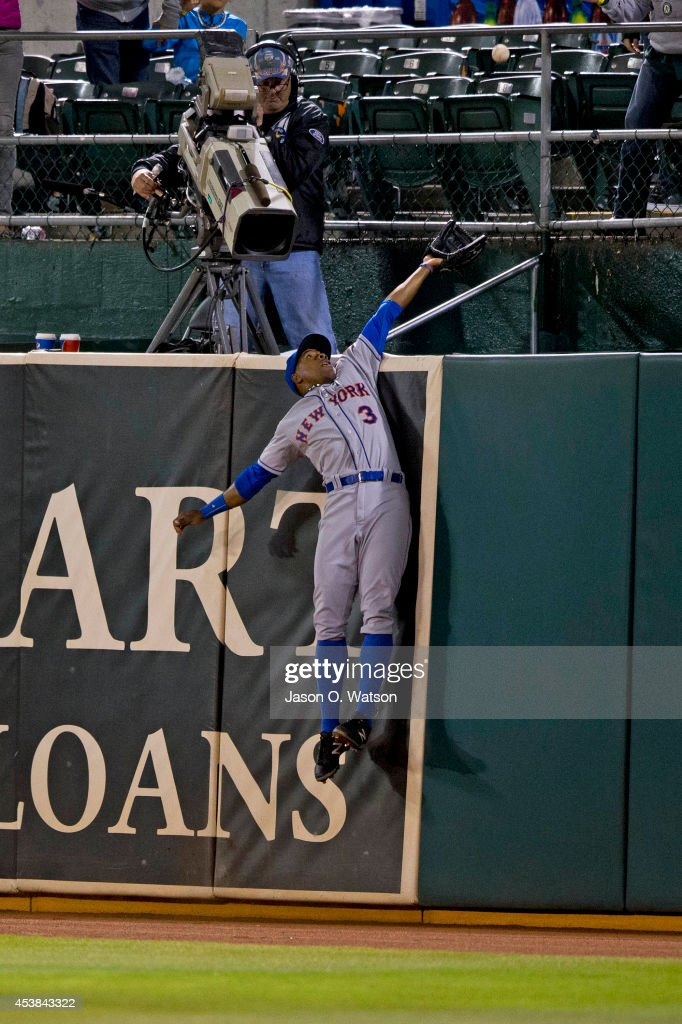 <a gi-track='captionPersonalityLinkClicked' href=/galleries/search?phrase=Curtis+Granderson&family=editorial&specificpeople=546997 ng-click='$event.stopPropagation()'>Curtis Granderson</a> #3 of the New York Mets leaps for but is unable to catch a ball hit for a two run home run by Josh Reddick (not pictured) of the Oakland Athletics during the eighth inning of an interleague game at O.co Coliseum on August 19, 2014 in Oakland, California. The Oakland Athletics defeated the New York Mets 6-2.