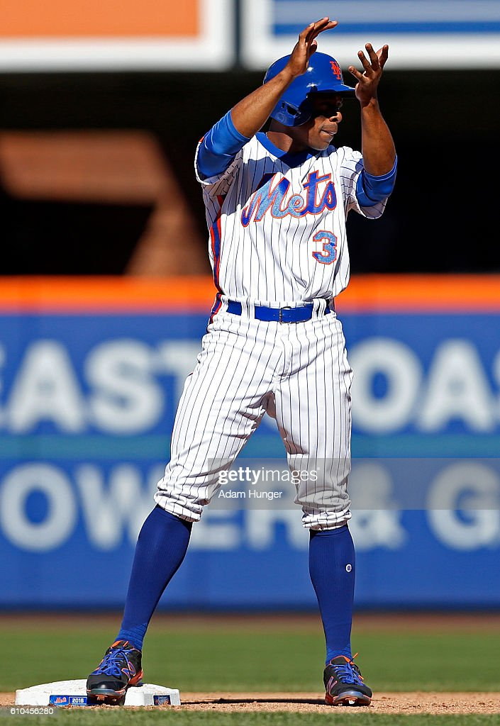 Curtis Granderson #3 of the New York Mets reacts standing on second base during the fifth inning against the Philadelphia Phillies at Citi Field on September 25, 2016 in the Flushing neighborhood of the Queens borough of New York City.