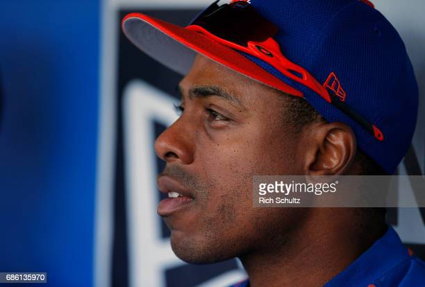 Curtis Granderson of the New York Mets sits in the dugout before batting practice prior to a game against the Philadelphia Phillies at Citizens Bank...