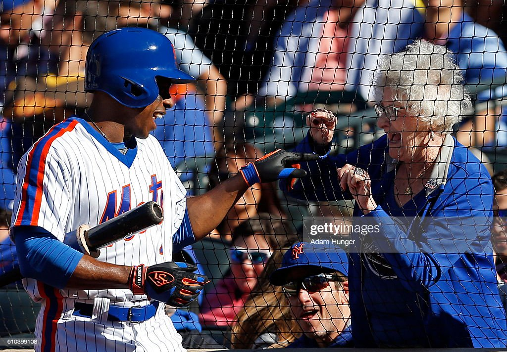 Curtis Granderson #3 of the New York Mets talks with a fan while in the on deck circle during the sixth inning against the Philadelphia Phillies at Citi Field on September 25, 2016 in the Flushing neighborhood of the Queens borough of New York City.