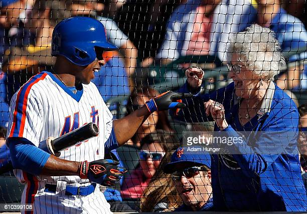 Curtis Granderson of the New York Mets talks with a fan while in the on deck circle during the sixth inning against the Philadelphia Phillies at Citi...