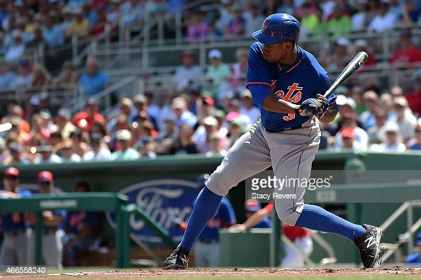 Curtis Granderson of the New York Mets waits for a pitch during a spring training game against the Boston Red Sox at JetBlue Park at Fenway South on...