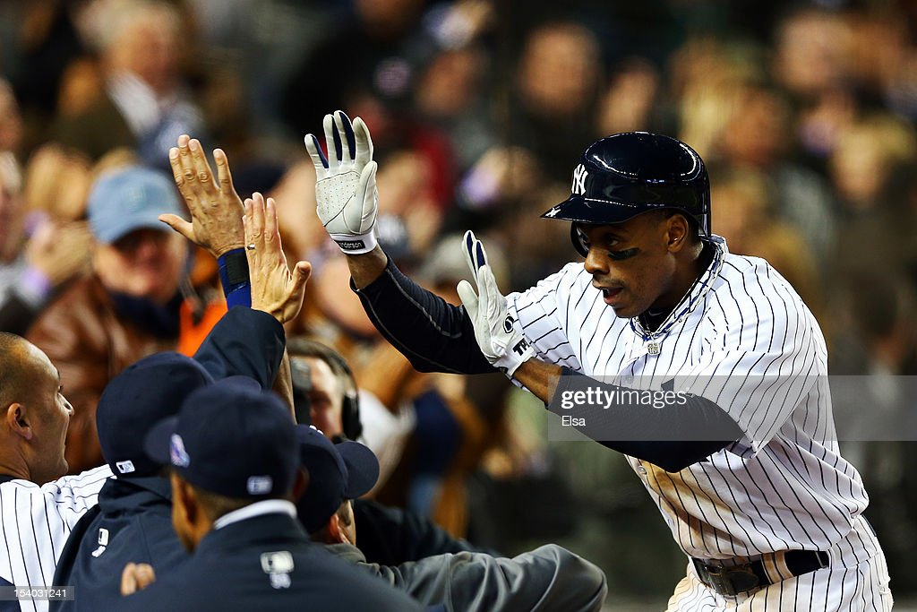 Curtis Granderson #14 of the New York Yankees celebrates after hitting a solo home run in the seventh inning against the Baltimore Orioles during Game Five of the American League Division Series at Yankee Stadium on October 12, 2012 in New York, New York.