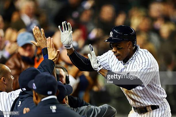 Curtis Granderson of the New York Yankees celebrates after hitting a solo home run in the seventh inning against the Baltimore Orioles during Game...