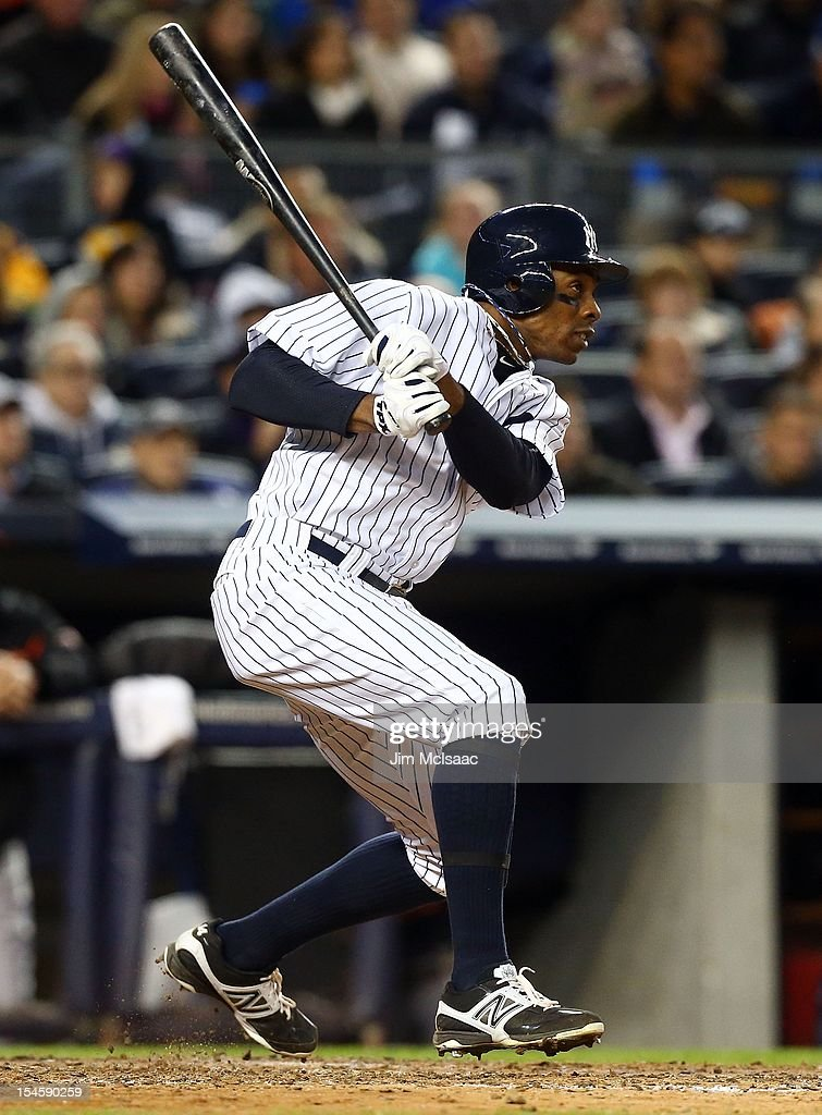 Curtis Granderson #14 of the New York Yankees in action against the Baltimore Orioles during Game Five of the American League Division Series at Yankee Stadium on October 12, 2012 in the Bronx borough of New York City. The Yankees defeated the Orioles 3-1 to win their best of five series three games to two.
