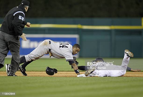 Curtis Granderson of the New York Yankees is tagged out after over sliding the base on a ninth inning steal by Jhonny Peralta of the Detroit Tigers...