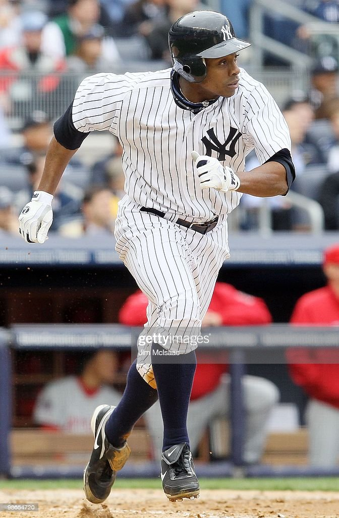 Curtis Granderson #14 of the New York Yankees runs against the Los Angeles Angels of Anaheim during the Yankees home opener at Yankee Stadium on April 13, 2010 in the Bronx borough of New York City.