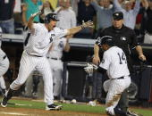 Curtis Granderson of the New York Yankees scores the winning run as Mark Teixeira in the ninth inning against the Tampa Bay Rays on July 16 2010 at...
