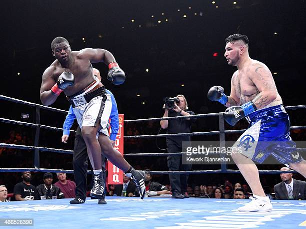 Curtis Harper escapes from Chris Arreola during their 10 round heavyweight bout at Citizens Business Bank Arena March 13 2015 in Ontario California