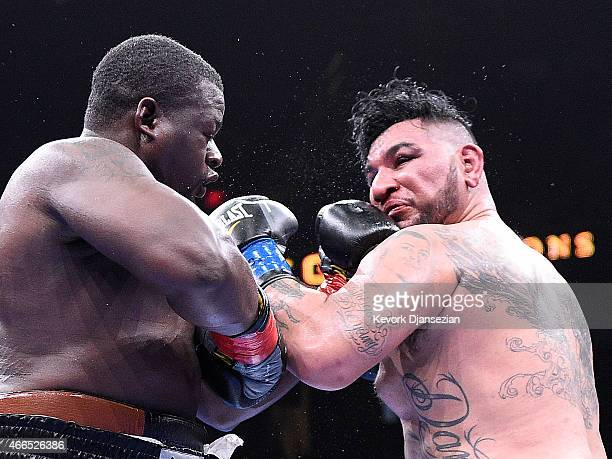 Curtis Harper throws a punch against Chris Arreola during their 10 round heavyweight bout at Citizens Business Bank Arena March 13 2015 in Ontario...