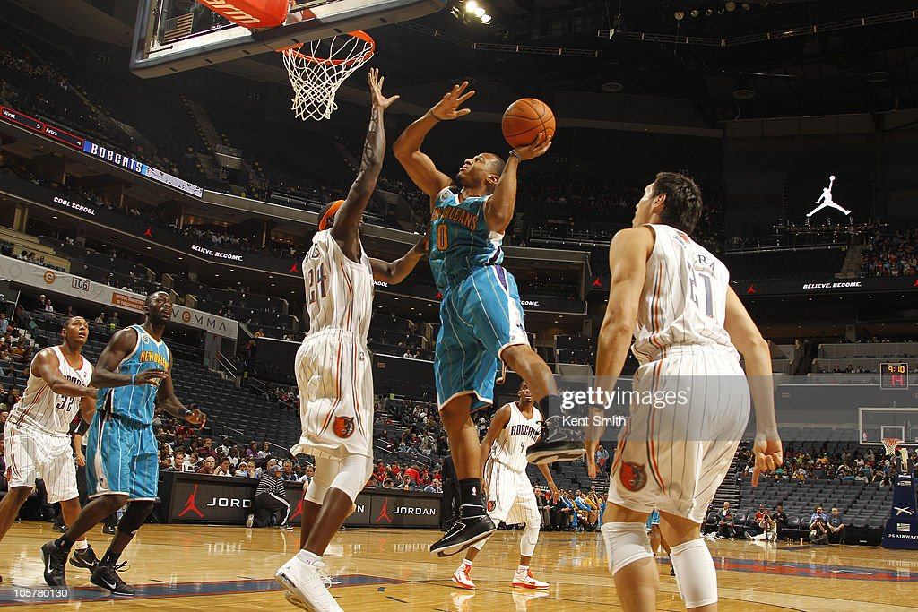 Curtis Jerrells #0 of the New Orleans Hornets shoots against <a gi-track='captionPersonalityLinkClicked' href=/galleries/search?phrase=Darius+Miles&family=editorial&specificpeople=201702 ng-click='$event.stopPropagation()'>Darius Miles</a> #24 of the Charlotte Bobcats on October 20, 2010 at Time Warner Cable Arena in Charlotte, North Carolina.