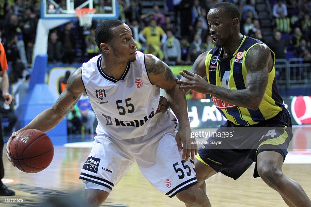 Curtis Jerrels #55 of Besiktas JK Istanbul competes with Bo McCalebb #4 of Fenerbahce Ulker Istanbul during the 2012-2013 Turkish Airlines Euroleague Top 16 Date 7 between Fenerbahce Ulker Istanbul v Besiktas JK Istanbul at Fenerbahce Ulker Sports Arena on February 15, 2013 in Istanbul, Turkey.