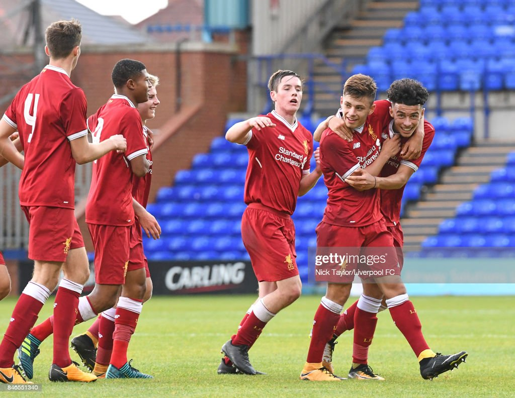 Curtis Jones (right) of Liverpool celebrates scoring the third goal for Liverpool with team mates (l-r) Conor Masterson, Rhian Brewster, Edvard Sandvik Tagseth, Liam Coyle and Adam Lewis during the UEFA Champions League group E match between Liverpool FC and Sevilla FC at Prenton Park on September 13, 2017 in Birkenhead, United Kingdom.