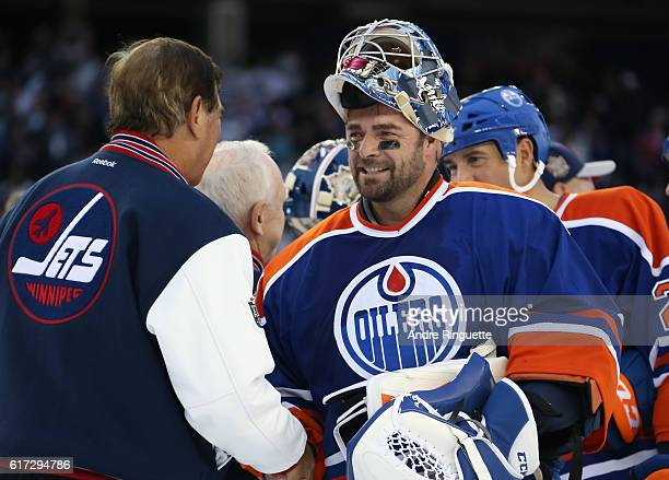 Curtis Joseph of the Edmonton Oilers alumni shakes hands after a 65 loss to Winnipeg Jets alumni during the 2016 Tim Hortons NHL Heritage Classic...
