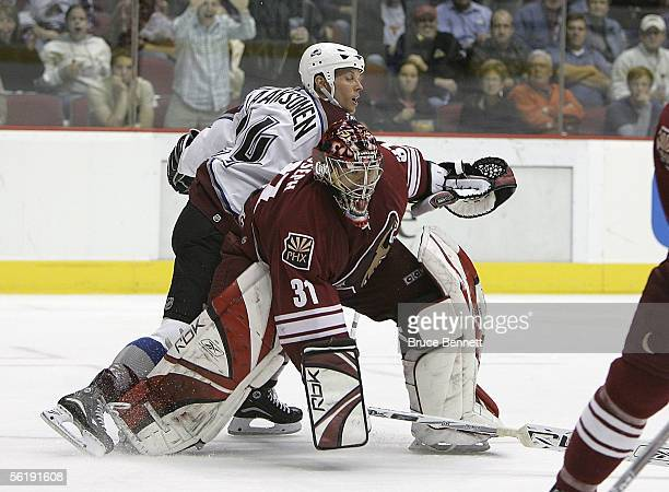 Curtis Joseph of the Phoenix Coyotes comes out of the net to block Antti Laaksonen of the Colorado Avalanche on November 16 2005 at the Glendale...