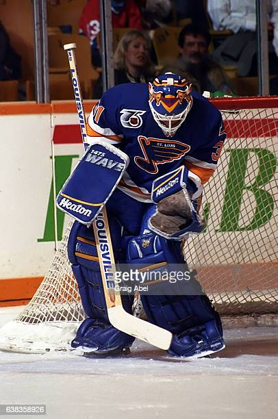 Curtis Joseph of the St Louis Blues stops a shot against the Toronto Maple Leafs during NHL game action on October 28 1991 at Maple Leaf Gardens in...