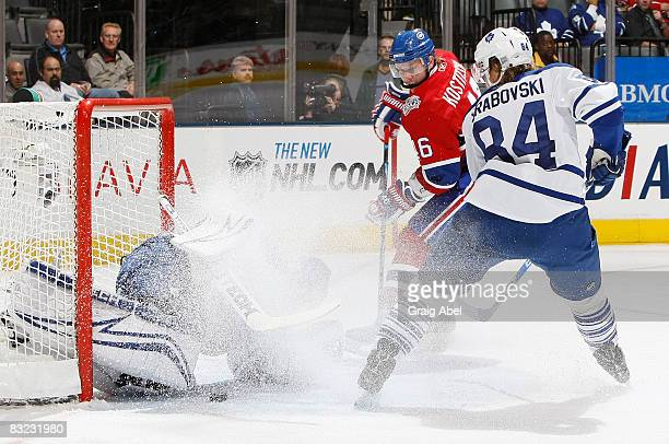 Curtis Joseph of the Toronto Maple Leafs is sprayed with snow by team mate Mikhail Grabovski and Andrei Kostitsyn of the Montreal Canadiens during...