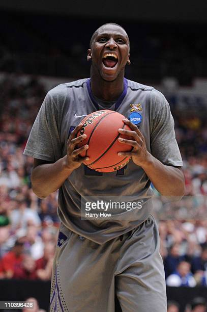 Curtis Kelly of the Kansas State Wildcats celebrates during their game against the Utah State Aggies during the second round of the 2011 NCAA men's...