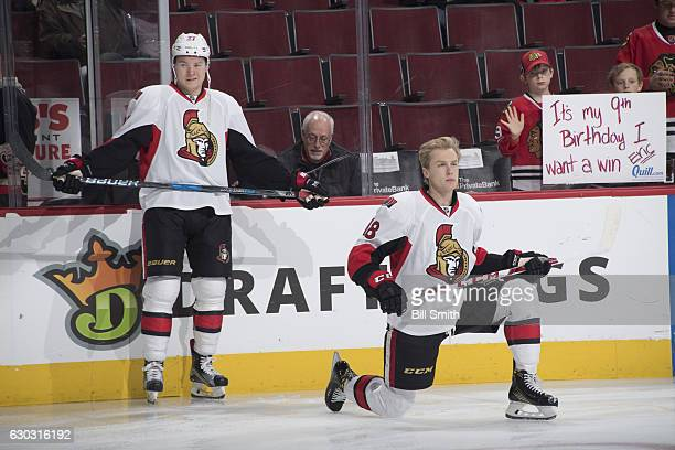 Curtis Lazar and Ryan Dzingel of the Ottawa Senators warm up prior to the game against the Chicago Blackhawks at the United Center on December 20...