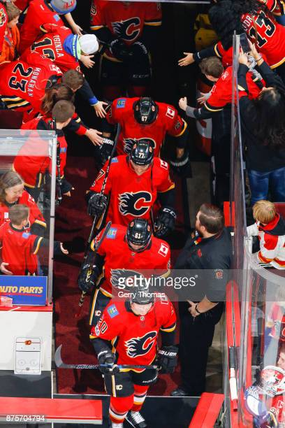 Curtis Lazar Brett Kulak Mark Jankowski and Michael Frolik enter the ice in an NHL game against the St Louis Blues at the Scotiabank Saddledome on...