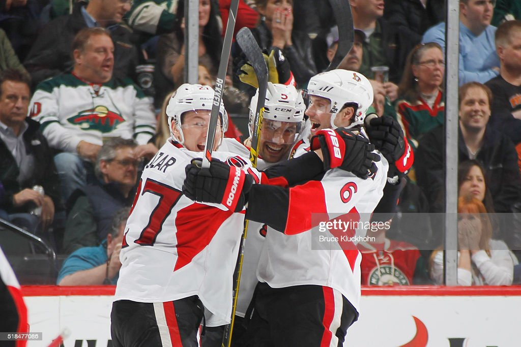 Curtis Lazar Cody Ceci and Bobby Ryan of the Ottawa Senators celebrate after scoring a goal against the Minnesota Wild during the game on March 31...
