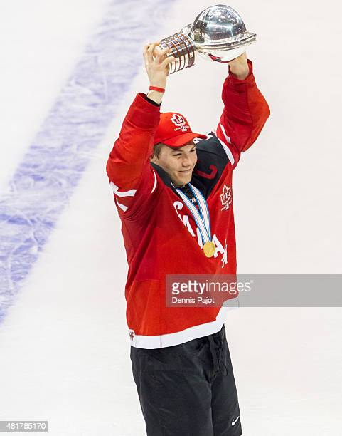 Curtis Lazar of Canada celebrates with the trophy after a 54 win against Russia during the Gold medal game of the 2015 IIHF World Junior Championship...