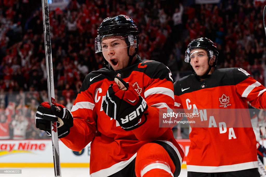 <a gi-track='captionPersonalityLinkClicked' href=/galleries/search?phrase=Curtis+Lazar&family=editorial&specificpeople=8636170 ng-click='$event.stopPropagation()'>Curtis Lazar</a> #26 of Team Canada celebrates his goal in a preliminary round game during the 2015 IIHF World Junior Hockey Championships against Team United States at the Bell Centre on December 31, 2014 in Montreal, Quebec, Canada.