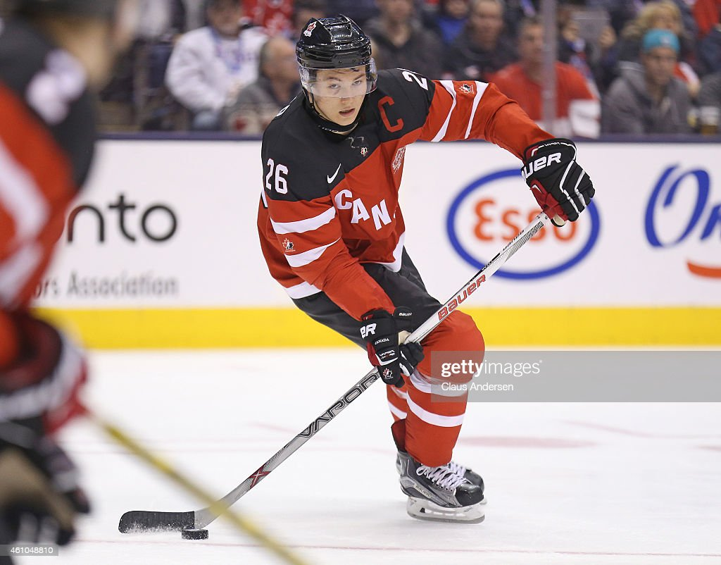 <a gi-track='captionPersonalityLinkClicked' href=/galleries/search?phrase=Curtis+Lazar&family=editorial&specificpeople=8636170 ng-click='$event.stopPropagation()'>Curtis Lazar</a> #26 of Team Canada skates with the puck against Team Slovakia during a semi-final game at the 2015 IIHF World Junior Hockey Championship at the Air Canada Centre on January 4, 2015 in Toronto, Ontario, Canada. Team Canada defeated Team Slovakia 5-1 to advance to the gold medal final.