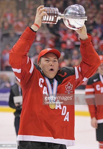 Curtis Lazar of Team Canada skates with the winning trophy after defeating Team Russia in the Gold medal game in the 2015 IIHF World Junior Hockey...
