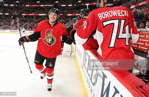 Curtis Lazar of the Ottawa Senators celebrates his second period goal against the Toronto Maple Leafs at the players' bench at Canadian Tire Centre...