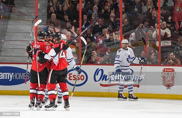 Curtis Lazar of the Ottawa Senators celebrates his second period goal with teammates Erik Karlsson and Ryan Dzingel as Nazem Kadri of the Toronto...