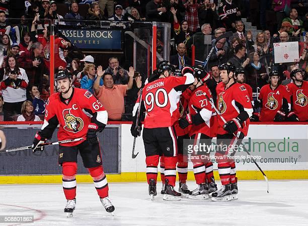 Curtis Lazar of the Ottawa Senators celebrates his second period goal against the Toronto Maple Leafs with team mates Erik Karlsson Alex Chiasson and...