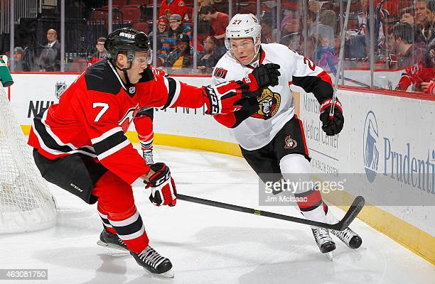 Curtis Lazar of the Ottawa Senators in action against Jon Merrill of the New Jersey Devils at the Prudential Center on February 3 2015 in Newark New...