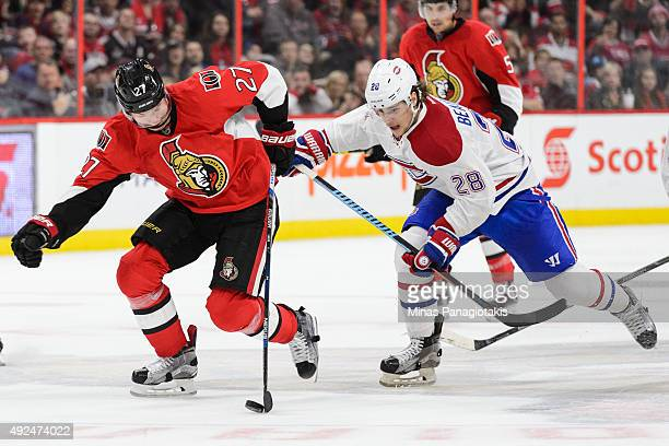 Curtis Lazar of the Ottawa Senators moves the puck past Nathan Beaulieu of the Montreal Canadiens during the NHL game at Canadian Tire Centre on...