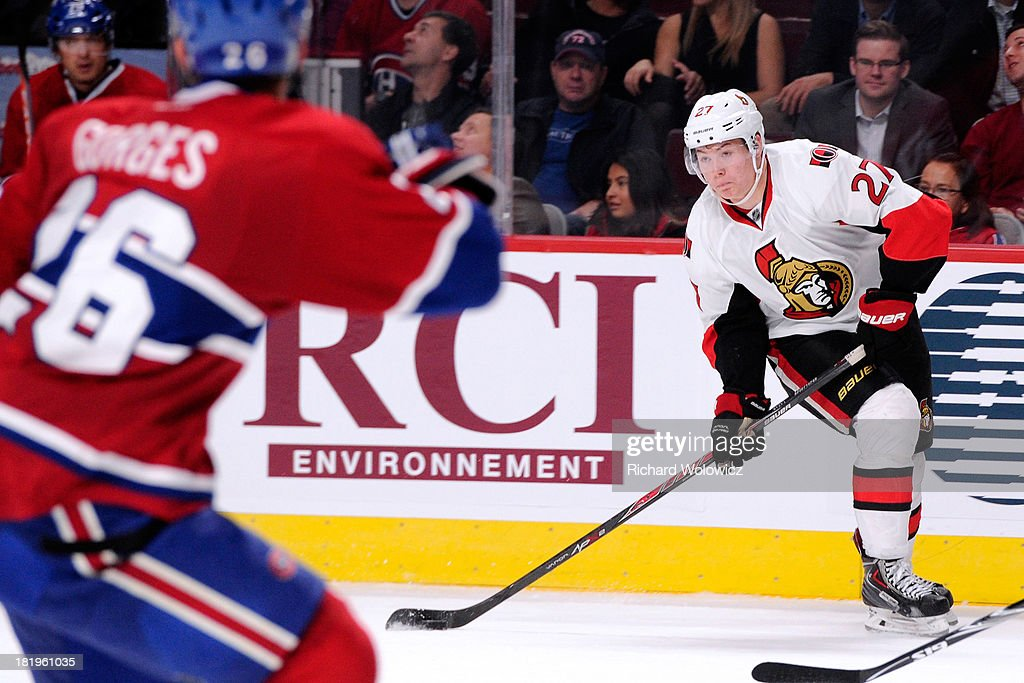 <a gi-track='captionPersonalityLinkClicked' href=/galleries/search?phrase=Curtis+Lazar&family=editorial&specificpeople=8636170 ng-click='$event.stopPropagation()'>Curtis Lazar</a> #27 of the Ottawa Senators passes the puck against the Montreal Canadiens during an NHL preseason game at the Bell Centre on September 26, 2013 in Montreal, Quebec, Canada. The Canadiens defeated the Senators 3-1.