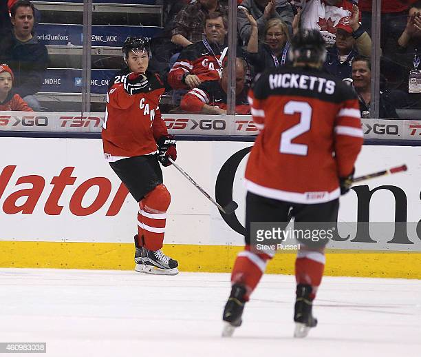 TORONTO ON JANUARY 2 Curtis Lazar signals to Joe Rocketts as Team Canada plays Team Denmark in the quarter final round of the IIHF World Junior...
