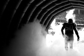 Curtis Lofton of the Atlanta Falcons runs out of the tunnel during player introductions before facing the Baltimore Ravens at Georgia Dome on...